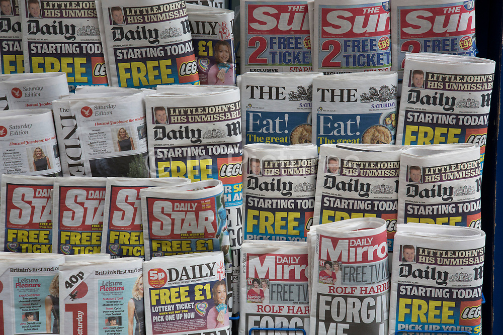 Stand of tabloid newspapers at a newsagents. London, UK. The Sun, ther Daily Mail, The Star, Daily Mirror predominantly.