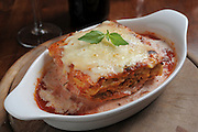 a serving of Cheese crusted lasagna
