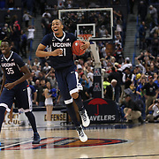 Omar Calhoun and Amida Brimah, (left), UConn, celebrate victory during the UConn Huskies Vs Tulsa Semi Final game at the American Athletic Conference Men's College Basketball Championships 2015 at the XL Center, Hartford, Connecticut, USA. 14th March 2015. Photo Tim Clayton