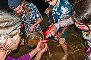 Cake, berries, & whipped cream served directly into hands held over the river at night. Rafting through Marble Canyon, on Day 3 of 16 days boating 226 miles down the Colorado River in Grand Canyon National Park, Arizona, USA.