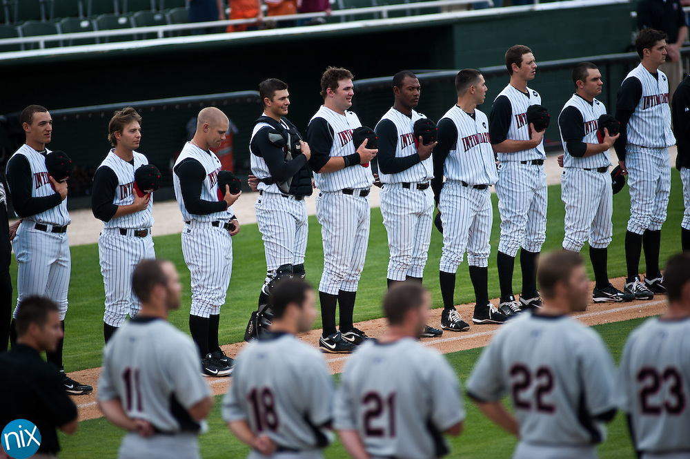 Kannapolis and Hickory players listen to the national anthem prior to the home opener for the Intimidators at Fieldcrest Cannon Stadium. The Intimidators won the game 5-3 and improved their record to 7-1. (Photo by James Nix)