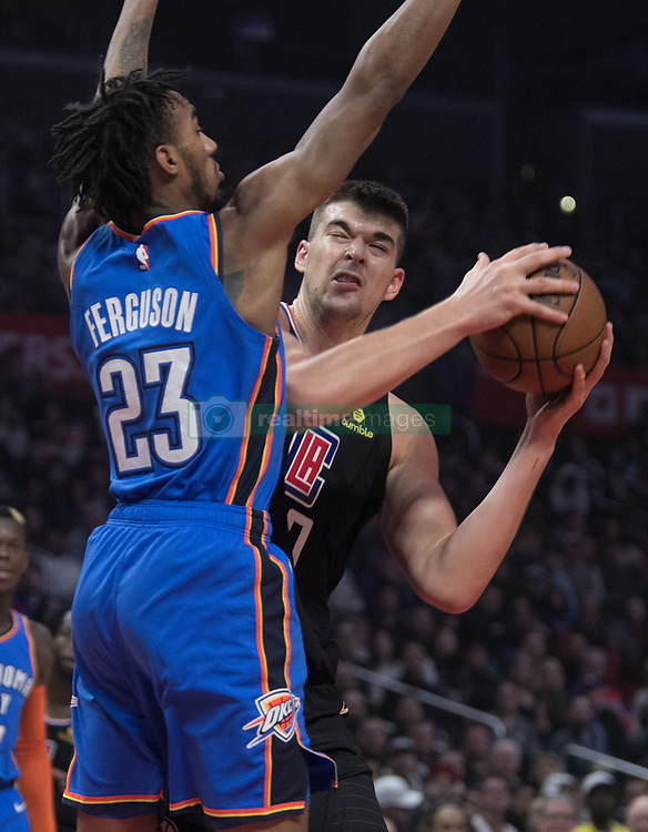 March 8, 2019 - Los Angeles, California, U.S - Ivica Zubac #40 of the Los Angeles Clippers tries to get past Terrance Ferguson #23 of the Oklahoma Thunder during their NBA game on Friday March 8, 2019 at the Staples Center in Los Angeles, California. JAVIER ROJAS/PI (Credit Image: © Prensa Internacional via ZUMA Wire)