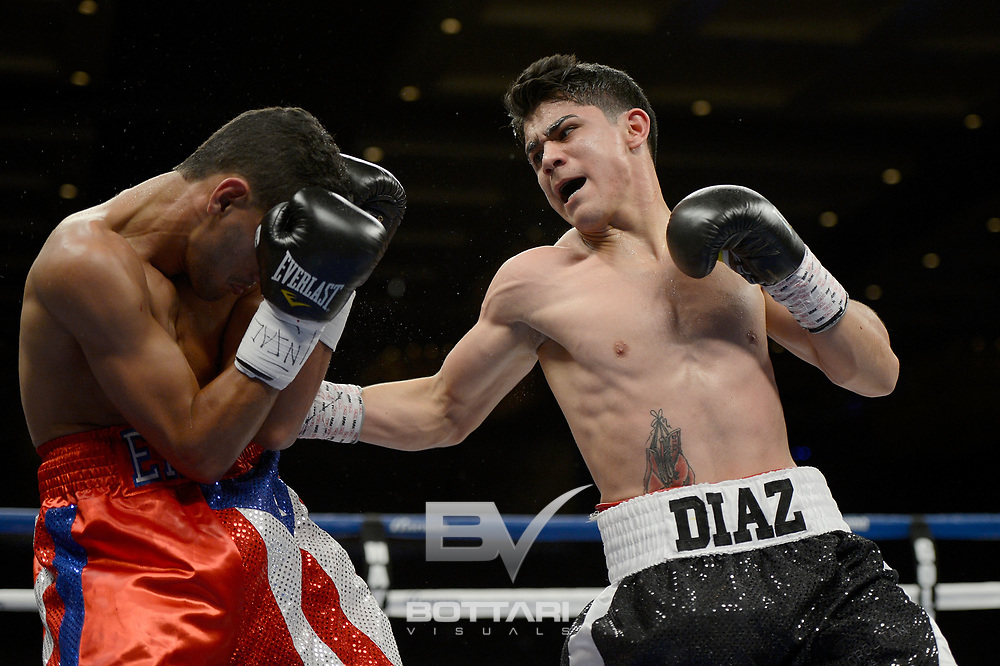LAS VEGAS, NV - MAY 03:  Joseph Diaz Jr. (R) lands a right to the body of Eric Gotay during their junior fetherweight bout at The Chelsea at The Cosmopolitan of Las Vegas on May 3, 2013 in Las Vegas, Nevada.  (Photo by Jeff Bottari/Golden Boy/Golden Boy via Getty Images)