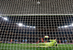 Goalkeeper of Uruguay Fernando Muslera watches when Asamoah Gyan (3) of Ghana misses a goal at penalty shot in last minute of overtime during the 2010 FIFA World Cup South Africa Quarter Finals football match between Uruguay and Ghana on July 02, 2010 at Soccer City Stadium in Sowetto, suburb of Johannesburg. (Photo by Vid Ponikvar / Sportida)