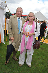 NICHOLAS & ANNIE COLQUOHOUN-DENVERS at the 2012 Veuve Clicquot Gold Cup Final at Cowdray Park, Midhurst, West Sussex on 15th July 2012.