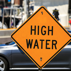 Annapolis, MD / USA - July 9, 2017: A high water sign posted near the docks in Maryland's capital city.