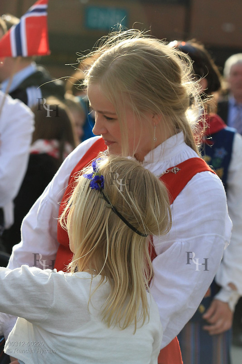 Mother and daughter wear bunads (national costumes) for May 17th Constitution Day celebration of nation's independence in Kirkenes, Norway.