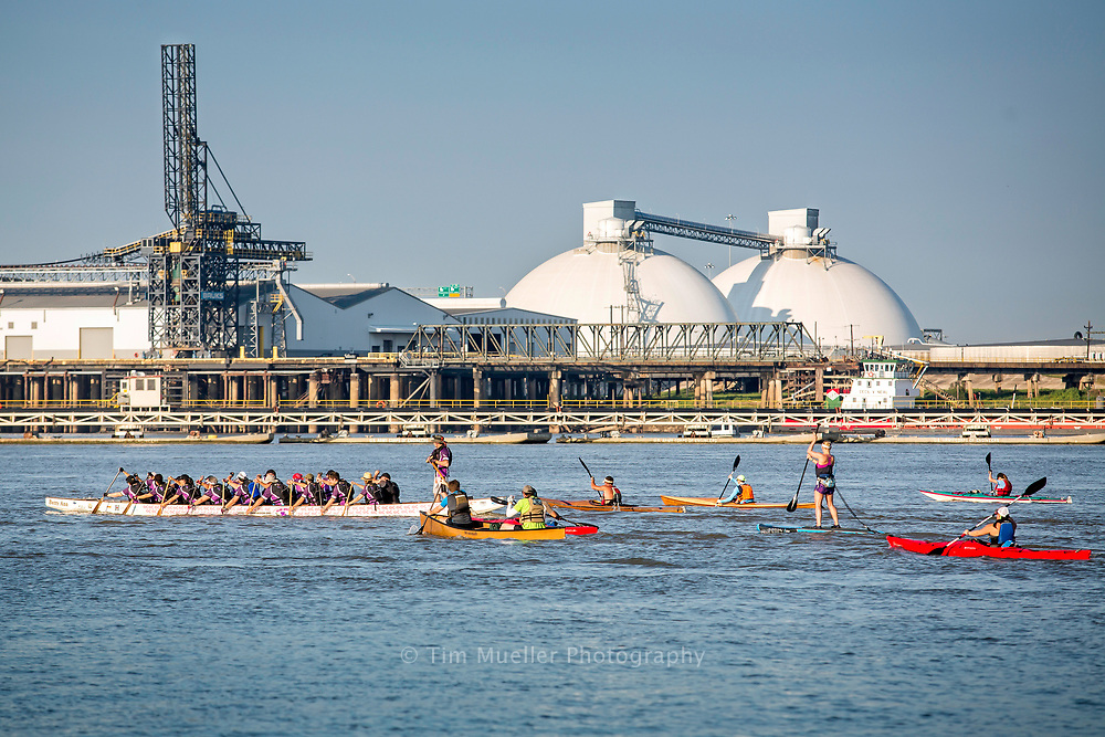Stand up paddlers and kayakers race down the Mississippi river over the Labor Day weekend during the Big River Regional. The 13-mile event starts in downtown Baton Rouge and ends at the L'auberge Hotel and Casino.