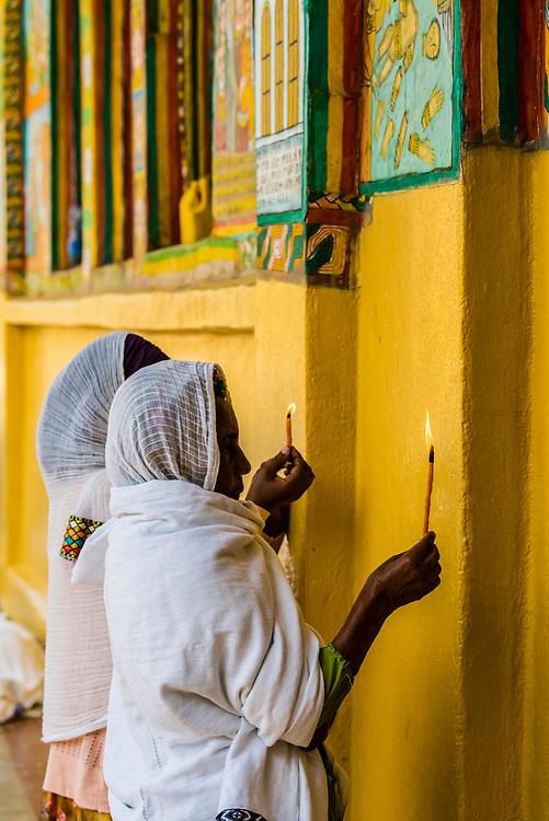 Women holding candles and praying, Saint Yared Church (Ethiopian Orthodox Church), Axum (Aksum), Ethiopia.