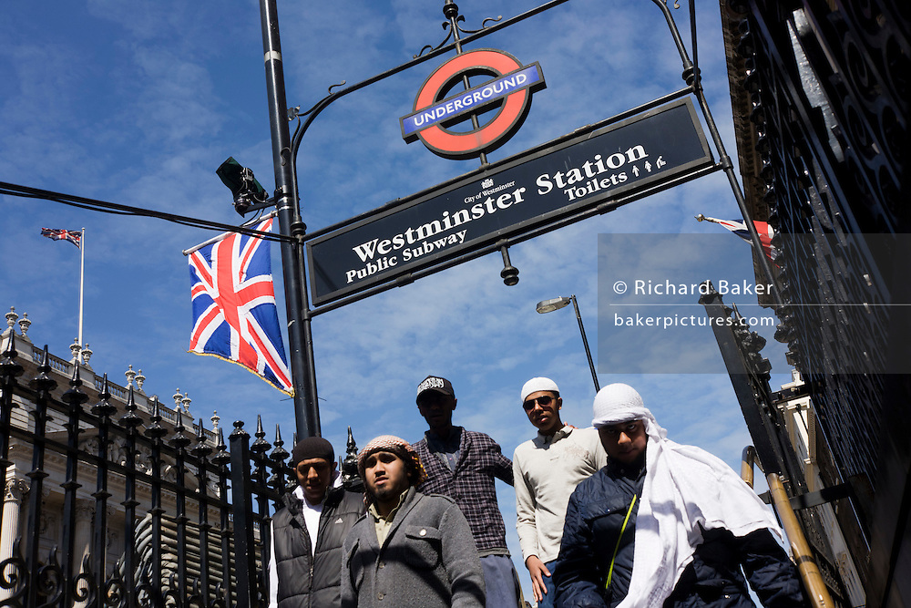 A small ghroup of Islamist radicals descend into Westminster underground tube station days before the royal marriage of Prince William and his wife-to-be Kate Middleton in London. Seen as a security threat, the young males are nonetheless left alone by police officers although they are undoutedly under surveillance as they walk along the wedding procession route. Muslim groups have been denied permission to demonstrate against the wedding event and will risk arrest if stopped with anti-British/monarchist literature.