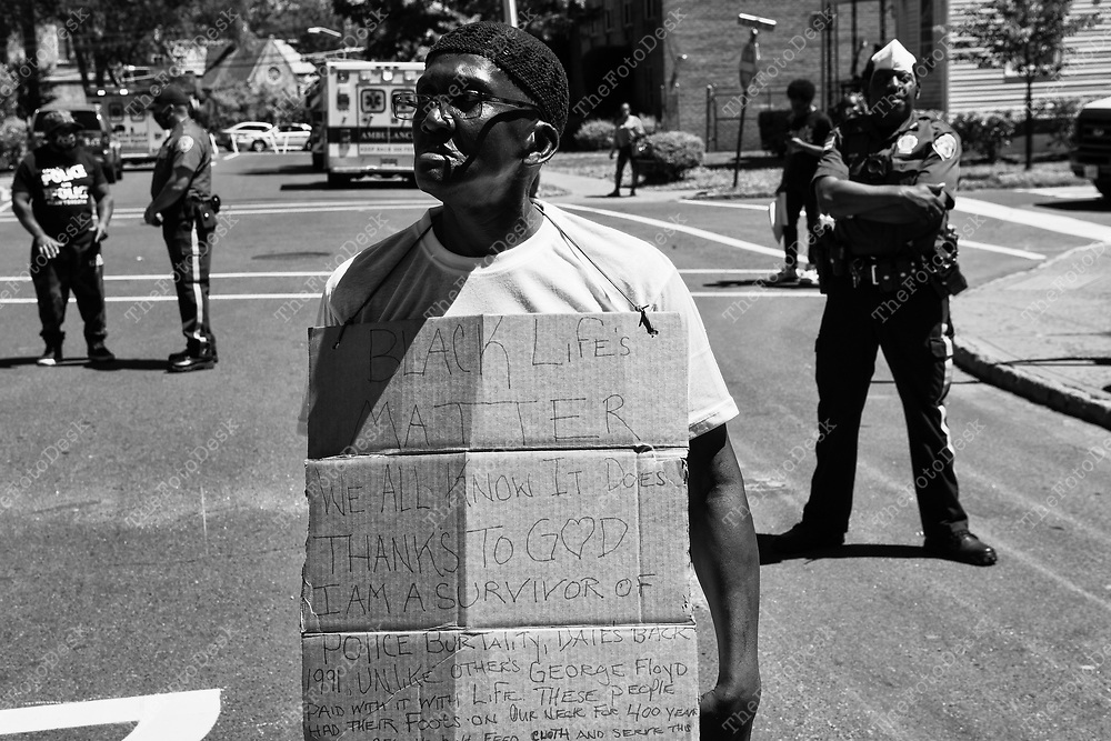 """PLAINFIELD, NEW JERSEY:  Glen Butler, 57 of Plainfield speaks during a peaceful demonstration at Plainfield City Hall in Plainfield, New Jersey on Saturday, June 13, 2020.  A small crown of nearly 100 demonstrators participated in the second George Floyd march and rally in Plainfield. """"Enough is Enough."""" Every bone in my face was broken by Plainfield Police in 1991."""" Said, Butler (Brian Branch-Price/TheFotoDesk)"""