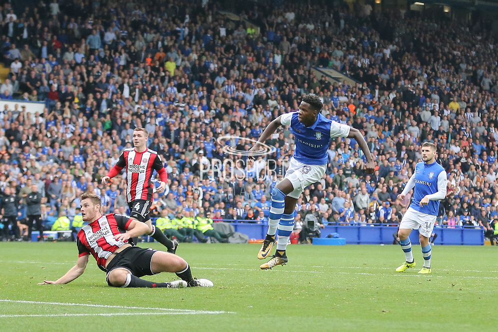 Sheffield Wednesday forward Lucas Joao (18) scores a goal 2-2 during the EFL Sky Bet Championship match between Sheffield Wednesday and Sheffield Utd at Hillsborough, Sheffield, England on 24 September 2017. Photo by Phil Duncan.
