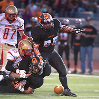 Gallup Bengal Isaiah Mike-Dubois (24) fumbles the ball and it is recovered by Espanola Valley in the homecoming game at Public School Stadium Friday.