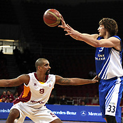 Galatasaray's Preston Shumpert (L) and Turk Telekom's Simas Jasaitis (R) during their BEKO Basketball League match Galatasaray between Turk Telekom at the Abdi Ipekci Arena in Istanbul at Turkey on Sunday, December 25 2011. Photo by TURKPIX
