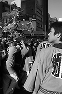 """This is the Sanja Matsuri or Sanja Festival, the biggest of Tokyo's """"Three Grand Festivals"""". Held in the historical Asakusa district, this event is when traditional mikoshi (portable shrine) are paraded through the streets and surrounding neighborhoods of Asakusa Shrine and Sensoji Temple. Primarily a ritual rooted in Shinto religion, mikoshi festivals involve carrying around heavy portable shrines that are considered vehicles for a shrine's deities. They are meant to bring blessings, good luck and prosperity to wherever they pass through. But in addition to the religious importance, these festivals are a way to unwind and always involve lots of eating, drinking, dancing and other sorts of merriment. Put on by the Asakusa Shrine, the Sanja Festival takes place annually in mid May and involves up to 100 mikoshi. It dates back to the Edo period (1603 to 1868) and attracts over 1.5 million visitors."""