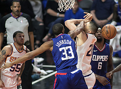 October 21, 2017 - Los Angeles, California, U.S - Wesley Johnson #33 of the Los Angeles Clippers goes commits a foul on Alex Len #21 of the Phoenix Suns during their first season game on Saturday October 21, 2017 at the Staples Center in Los Angeles, California. Clippers defeat Suns, 130-88. (Credit Image: © Prensa Internacional via ZUMA Wire)