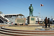 statue of admiral Heihachiro Togo with the historic battleship Mikasa in the back ground Yokosuka Japan