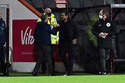 Nottingham Forset manager Chris Hughton fist bumps AFC Bournemouth manager Jason Tindall before kickoff during the EFL Sky Bet Championship match between Bournemouth and Nottingham Forest at the Vitality Stadium, Bournemouth, England on 24 November 2020.
