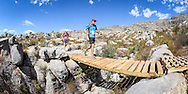 Andrew White leads Lara Kritzinger across a bridge during Stage 2 of the Tankwa Trail on the 18th of February 2017. Photo by Oakpics / Dryland Event Management / Sportzpics {dem16gst}