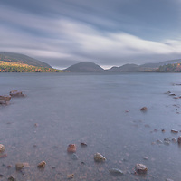 A serene sunset over the magical waters of Eagle Lake in Acadia National Park, Maine.