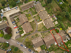 An aerial view showing the tiny patch of disputed land, centre-left, and the Timmins' home bottom right. Annette and Raymond Timmins who have Neighbouring pensioners have forked out thousands on a fierce 11-year battle with the owner of a neighbouring property - over a 76cm strip of land in a car park near their homes.. PLACE, September 12 2018.