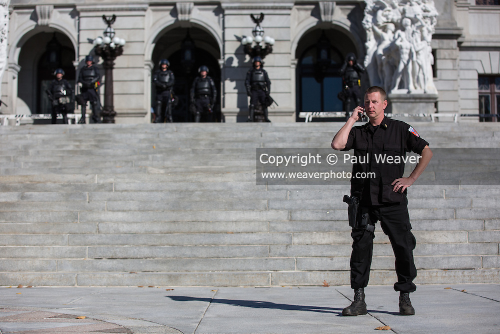 Ken Parker looks out the hundreds of protesters gathered at the Pennsylvania State Capitol before the start of the National Socialist Movement's fall political rally.