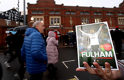 A general view of the match programme being held up before the Sky Bet Championship match at Craven Cottage, London.