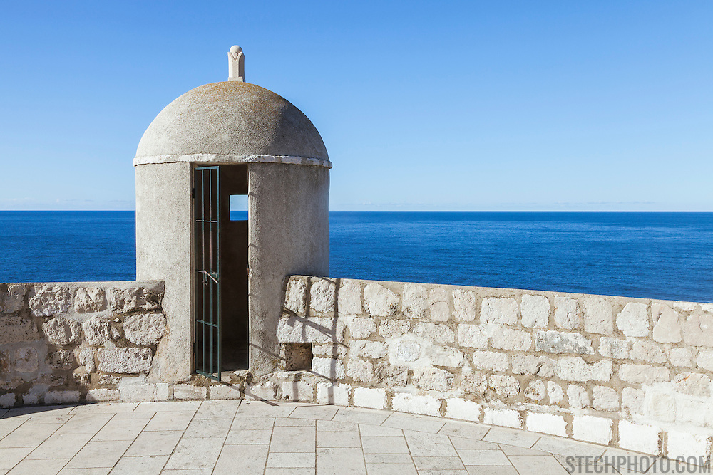 """An outpost overlooking the Adriatic Sea on the old city wall in Dubrovnik, Croatia. <br /> <br /> Dubrovnik serves as the official setting of """"King's Landing"""" from the popular TV show """"Game of Thrones"""".<br /> <br /> LICENSING: This is a Royalty Free (RF) image which can be licensed through SpacesImages. Click on the link below:<br /> <br /> http://tinyurl.com/cs3gtl4"""