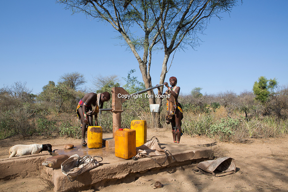 girls of the Hamer tribe fetching water