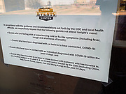 "13 MARCH 2020 - DES MOINES, IOWA: A sign at the entrance to Wells Fargo Arena, which is hosting the state boys high school basketball tournament. Tournament organizers announced that no spectators would be allowed at games starting Friday. The Governor of Iowa announced Friday that 17 people in Iowa have tested positive for the Novel Coronavirus. Of those, 15 people were exposed on the same cruise in Egypt, the others were exposed through travel but were not on the same cruise. The Governor said there has not yet been any ""community spread"" in Iowa. All of the Iowans who have tested positive are in self quarantine. Across Iowa, municipalities and businesses are taking steps to implement ""social distancing."" Most of the colleges in Iowa have announced that they will remain closed after their spring breaks and that classes will move to online only, after spring break. Many businesses in Des Moines, including Nationwide Insurance and EMC Insurance, have announced plans to have their employees to telecommute. The mayor of Des Moines has urged event planners to consider canceling large events.     PHOTO BY JACK KURTZ"