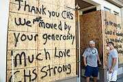 Charleston, United States. 31 May, 2020. A shop owner painted a message thanking volunteers on the boarded up store front along the King Street shopping district after a protest over the death of George Floyd, turned violent and destructive May 31, 2020 in Charleston, South Carolina. Floyd was choked to death by police in Minneapolis resulting in protests sweeping across the nation.  Credit: Richard Ellis/Alamy Live News