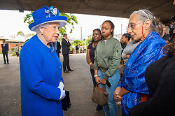 Queen Elizabeth II meets members of the community affected by the fire at Grenfell Tower in west London during a visit to the Westway Sports Centre which is providing temporary shelter for those who have been made homeless in the disaster.