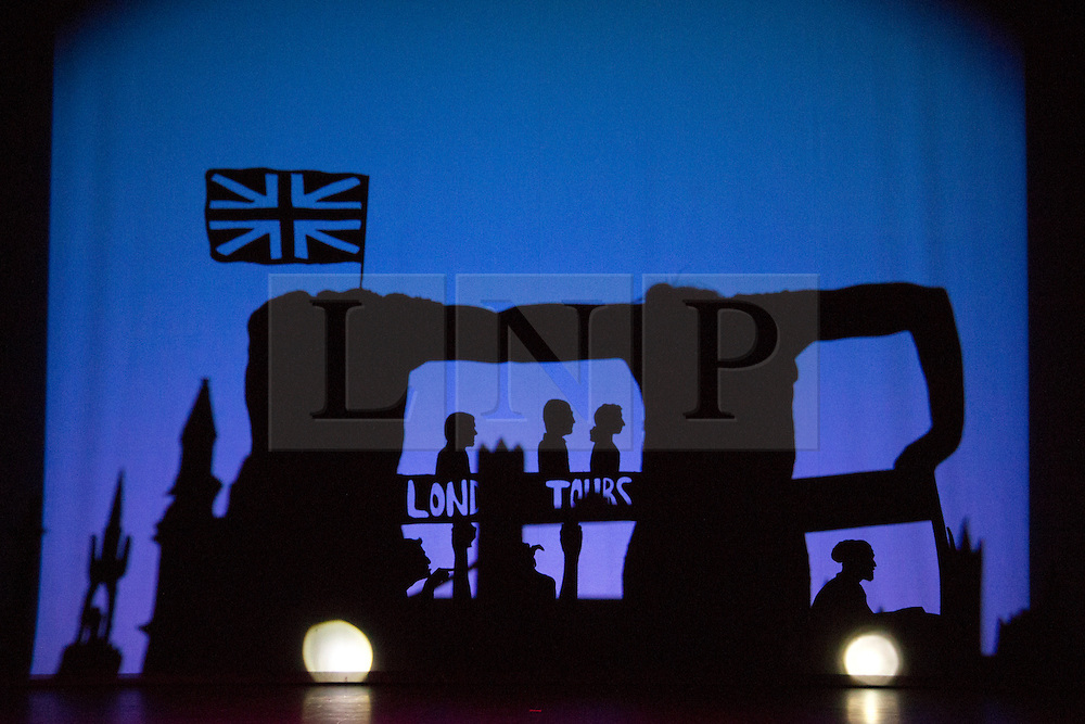 """© Licensed to London News Pictures. 12 March 2014. London, England. Pictured: Homage to London. Pilobolus dance troupe presents """"Shadowland"""", a show part dance, part circus, part concert utilising multiple moving screens. """"Shadowland"""" is performed for the first time in the UK. Created in collaboration with Steven Banks and featuring a score by David Poe, the show will run from 11 March to 30 March 2014 at the Peacock Theatre, London. Photo credit: Bettina Strenske/LNP"""