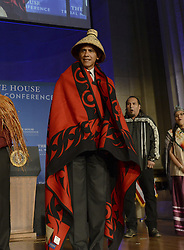 September 26, 2016 - Washington, DC, United States of America - U.S. President Barack Obama wearing a ceremonial blanket and hat during the White House Tribal Nations Conference at the Mellon Auditorium September 26, 2016 in Washington, DC. (Credit Image: © Interior Department/Planet Pix via ZUMA Wire)
