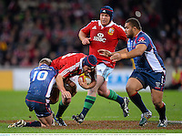 25 June 2013; Rory Best, British & Irish Lions, is tackled by Bryce Hegarty, Melbourne Rebels. British & Irish Lions Tour 2013, Melbourne Rebels v British & Irish Lions. AAMI Park, Olympic Boulevard, Melbourne, Australia. Picture credit: Stephen McCarthy / SPORTSFILE