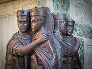 The Portrait of the Four Tetrarchs on a corner of the facade of St. Mark's Basilica on the Rio di Palazzo. A sculpture of four Roman Emperors