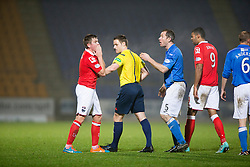 Ross County's  players at the ref after Saints second goal. <br /> St Johnstone 2 v 1 Ross County, Scottish Premiership 22/11/2014 at St Johnstone's home ground, McDiarmid Park.
