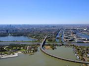 Nederland, Noord-Holland, Amsterdam;  03-23-2020; Zuiderzeeweg met Amsterdamse brug over Amsterdam-Rijnkanaal. Zicht op Indischebuurt, Zeeburg, Cruquiuseiland. Water van het Nieuwe Diep en monding van het AmsterdamRijnkanaal.<br /> Zuiderzeeweg with Amsterdam bridge over the Amsterdam-Rhine Canal. View of Indische Buurt, Zeeburg, Cruquiuseiland. Water from the Nieuwe Diep and the mouth of the Amsterdam-Rhine Canal.<br /> <br /> luchtfoto (toeslag op standard tarieven);<br /> aerial photo (additional fee required)<br /> copyright © 2020 foto/photo Siebe Swart