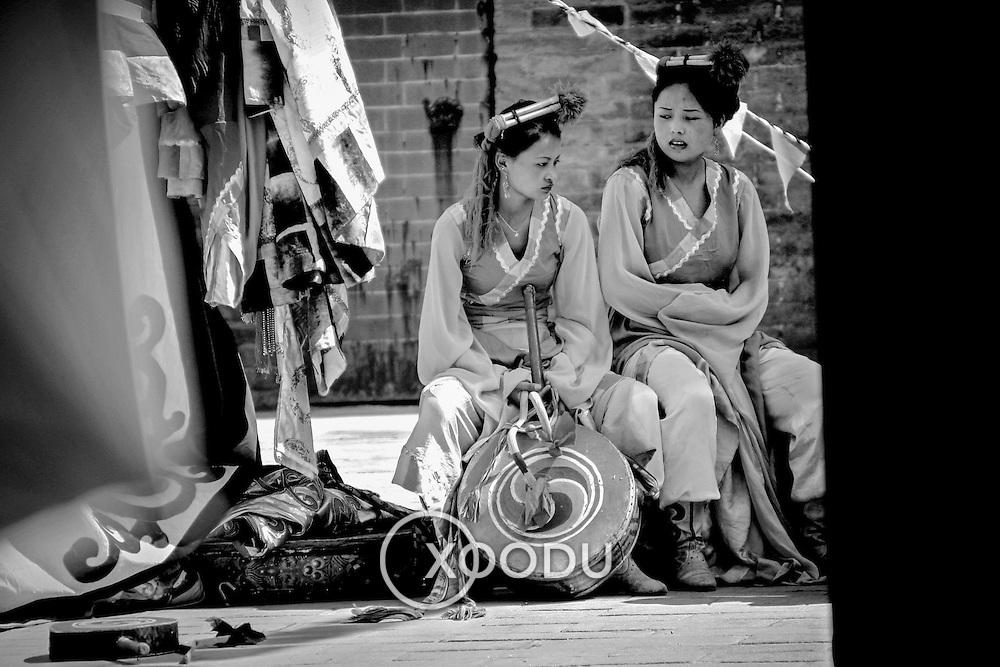 Tibetan dancers taking a break, Xian, China (May 2004)