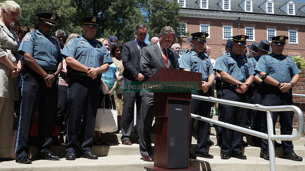 July 5, 2018 - Annapolis, MD, USA - Steve Schuh and other Anne Arundel County officials honor the victims of the shooting at the Capital Gazette at 2:33 p.m on July 5th, 2018. (Credit Image: © Jay Reed/TNS via ZUMA Wire)