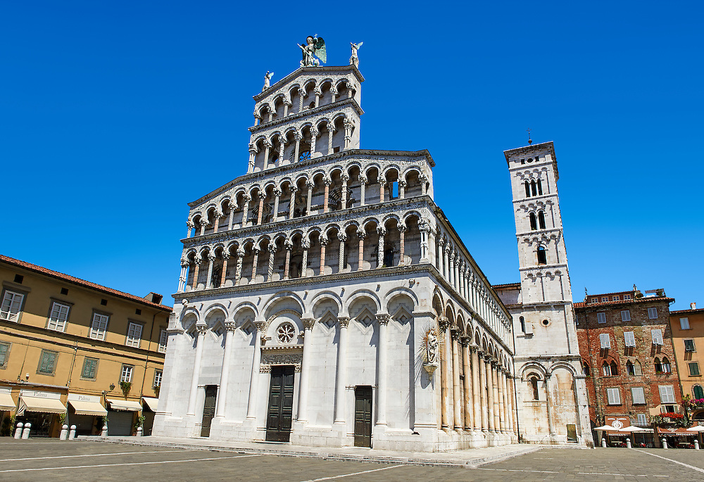 13th century facade and campinale of the San Michele in Foro is a Roman Catholic basilica church in Lucca, Tunscany, Italy .<br /> <br /> Visit our ITALY PHOTO COLLECTION for more   photos of Italy to download or buy as prints https://funkystock.photoshelter.com/gallery-collection/2b-Pictures-Images-of-Italy-Photos-of-Italian-Historic-Landmark-Sites/C0000qxA2zGFjd_k<br /> <br /> If you prefer to buy from our ALAMY PHOTO LIBRARY  Collection visit : https://www.alamy.com/portfolio/paul-williams-funkystock/lucca.html .