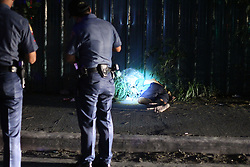 November 14, 2016 - Philippines - (EDITOR'S NOTE: Image depicts death) Members of S.O.C.O. (Scene of the Crime Operatives) and Philippine National Police (PNP) investigator process the crime scene and the remain of two un-identified summary execution victims at Diokno Blvd. Brgy 76, Zone 10, Pasay. It'Äôs a part of the total out war campaign by the government about illegal drugs. (Credit Image: © Gregorio B. Dantes Jr/Pacific Press via ZUMA Wire)