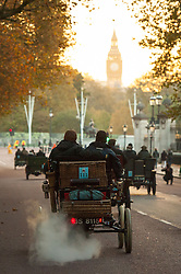 EDITORIAL USE ONLY Participants drive along Constitution Hill towards Big Ben during the Bonhams London to Brighton Veteran Car Run in London.