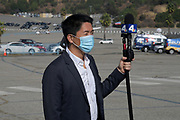 KNBC4 News reporter Ted Chen at the Los Angeles Dodgers Foundation 16th annual Thanksgiving Turkey Giveaway at Dodger Stadium, Thursday, Nov. 19, 2020, in Los Angeles.