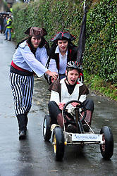 © Licensed to London News Pictures.01/01/2018<br /> SUTTON VALENCE, UK.<br /> PIRATE TEAM.<br /> The traditional New Years day Sutton Valence Pram Race in Kent continued this year. In its 38th year the Race was struck by tragedy last year when competitor Francis 'Titch' O' Sullivan tipped over in his spitfire pram and hit his head on the curb, he passed away a day later. A coroners court reported he was not wearing a helmet.<br />  All babies in the pram's have to wear a helmet and the pushers must have contact with the pram and the ground at all times.<br />  <br /> Photo credit: Grant Falvey/LNP
