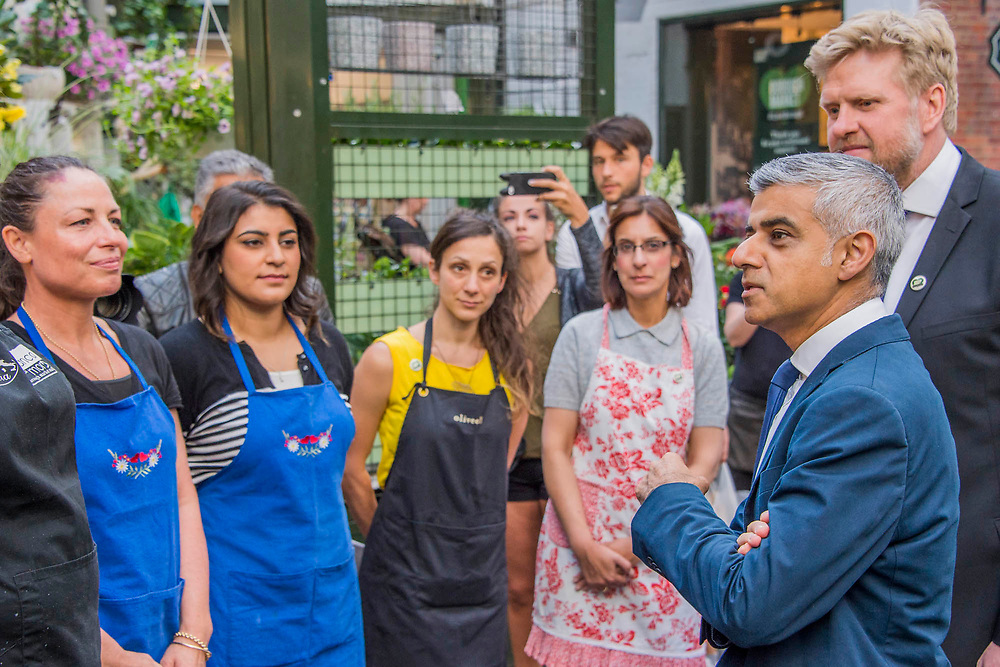 The Mayor Sadiq Khan meets stall holders - The market reopening is signified by the ringing of the bell and is attended by Mayor Sadiq Khan. Tourists and locals soon flood back to bring the area back to life. London 14 Jun 2017