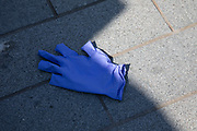 Surgical gloves discarded on the streets is a new phenomenon due to the Coronavirus pandemic, as seen here on 24th April 2020 in Birmingham, England, United Kingdom. Coronavirus or Covid-19 is a new respiratory illness that has not previously been seen in humans. While much or Europe has been placed into lockdown, the UK government has extended stringent rules as part of their long term strategy, and in particular social distancing, which has left usually bustling areas like a ghost town.