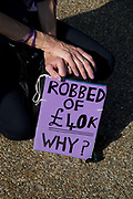 Women born in the 1950s held a Day of Action to draw attention to the women affected by the rise of the state pension age, from 60 to 66, organised by different groups including WASPI Women Against State Pension Inequality Campaign, BackTo60, and We Paid In You Pay Out on October 10th 2018 in London, United Kingdom. An older woman has a sign saying Robbed of £40k. Why ?