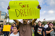 15 AUGUST 2012 - PHOENIX, AZ:  A girl and her undocumented immigrant father march on the Arizona State Capitol Wednesday. About 200 people, mostly DREAM Act  (an acronym for Development, Relief, and Education for Alien Minors) students and their family members, marched on the Arizona State Capitol in Phoenix Wednesday after Arizona Governor Jan Brewer said the state of Arizona will not give DREAM Act students any state services, including driver's licenses or tuition breaks on state universities and schools. Brewer has been a critic of President Obama's plan to defer deportations of certain undocumented young people.   PHOTO BY JACK KURTZ