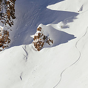 Forrest Jillson skis off of Cody Peak during a sunny morning in the Teton Backcountry.